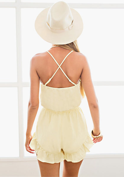 Back view of model in light yellow plunge bow-front romper