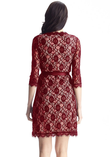 Back view of model in maroon lace overlay plunge wrap-style dress
