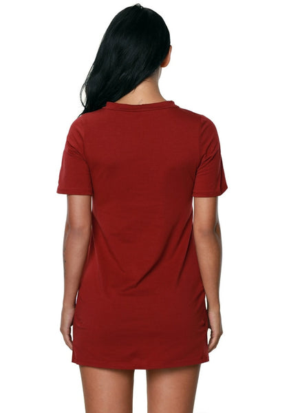Back view of model in maroon lace up tee dress