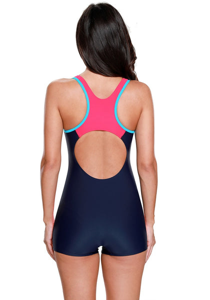 Back view of model in navy and hot pink racerback keyhole maillot swimsuit