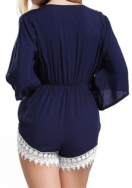 Back view of model in navy crochet romper