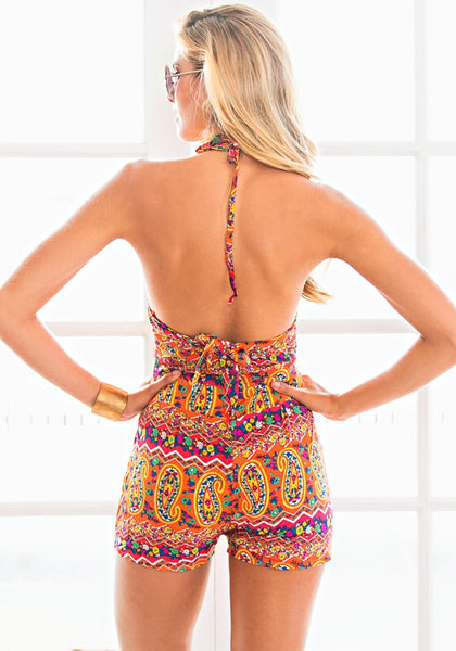 Back view of model in paisley print halter romper