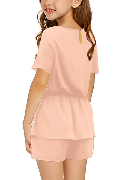 Back view of model in pink keyhole-back belted peplum girls romper