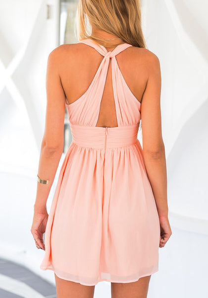 Back view of model in pink plunge halter skater dress