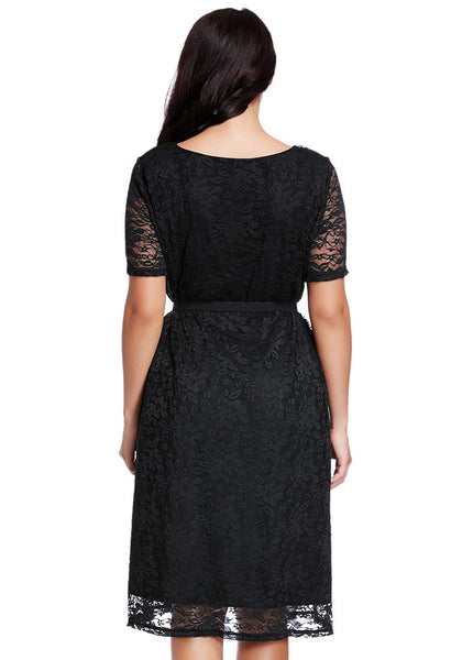 Back view of model in plus size black lace midi dress