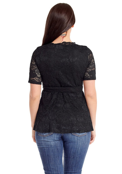 Back view of model in plus size black scallop-neck lace blouse