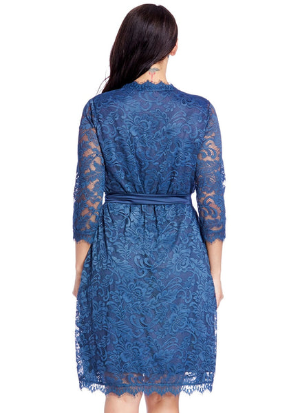 Back view of model in plus size blue lace crop sleeves wrap dress