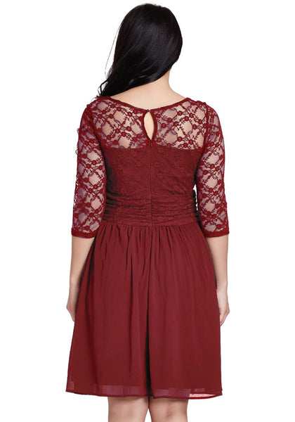 Back view of model in plus size burgundy lace crop-sleeves skater dress