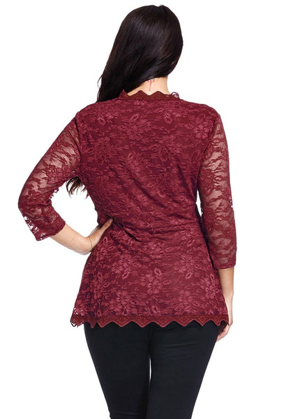 Back view of model in plus size burgundy lace scallop blouse