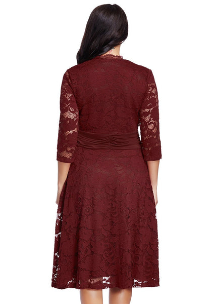 Back view of model in plus size burgundy lace surplice ruched-waist dress