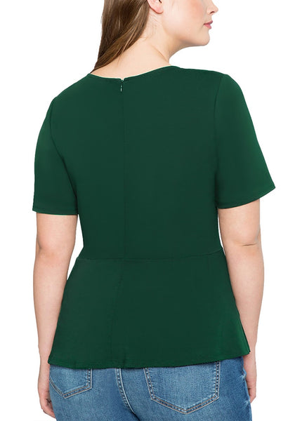 Back view of model in plus size dark green lace-up waist blouse