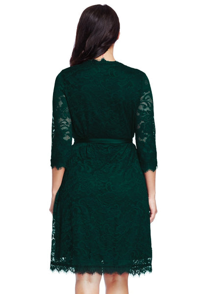 Back view of model in plus size deep green lace crop sleeves wrap dress