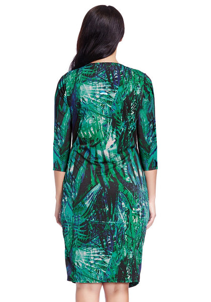 Back view of model in plus size green leaf-printed midi wrap dress