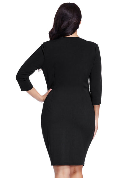 Back view of model in plus size green raglan sleeve dress