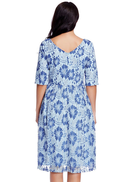 Back view of model in plus size light blue floral-print lace dress