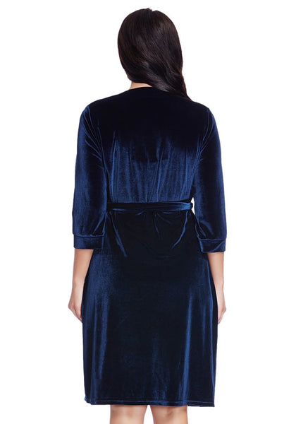 Back view of model in plus size navy blue velvet wrap dress