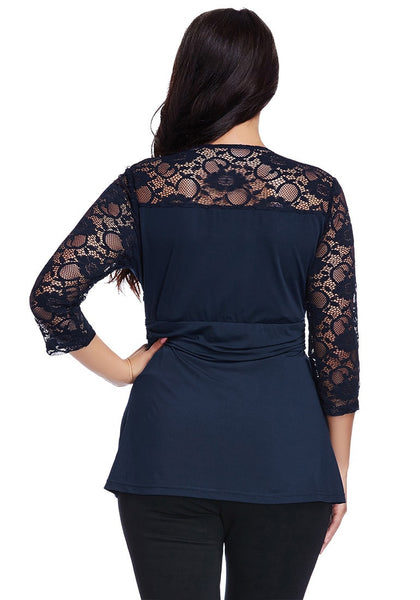 Back view of model in plus size navy lace navy wrap top