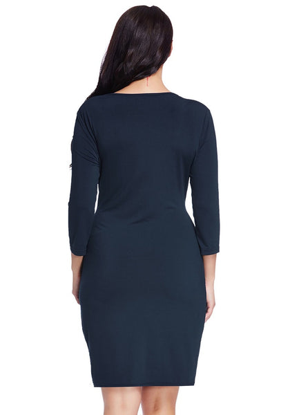 Back view of model in plus size navy sweetheart wrap midi dress
