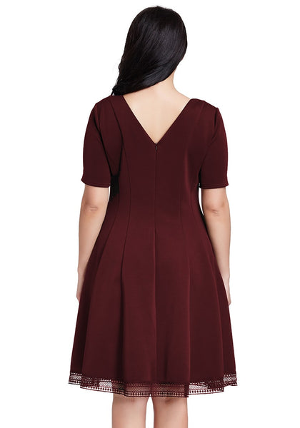 Back view of model in plus size port short-sleeves skater dress