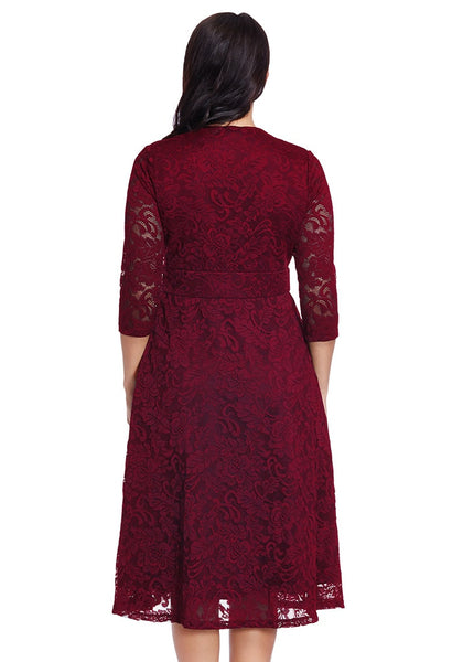 Back view of model in plus size red lace surplice midi dress