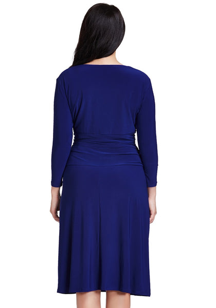 Back view of model in plus size royal blue ruched waist dress