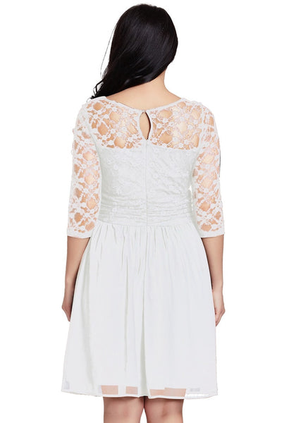 Back view of model in plus size white lace crop-sleeves skater dress