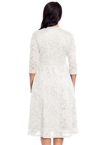 Back view of model in plus size white lace surplice midi dress