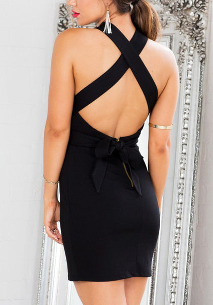 Back view of model in strappy black halter dress