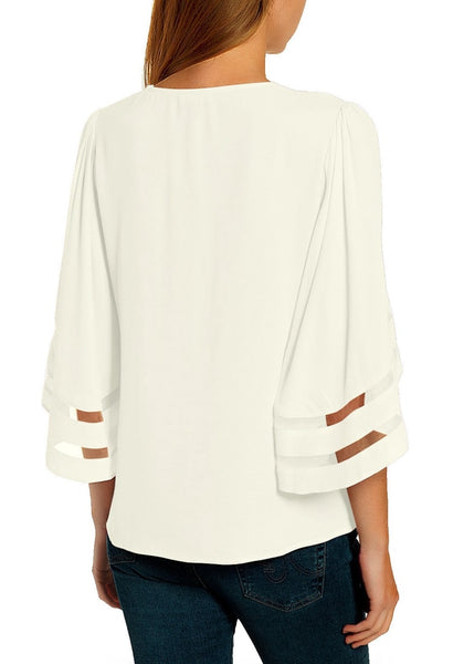 Back view of model in white 34 bell mesh panel sleeves strappy V-neckline loose top