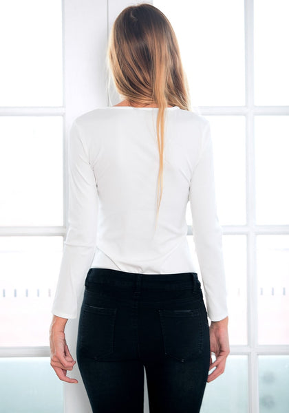 Back view of model in white chain lace-up bodysuit