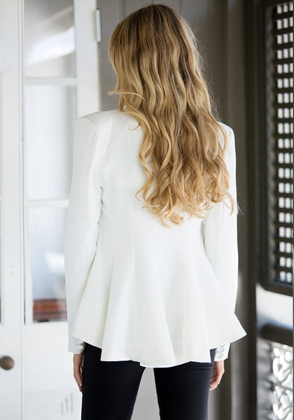 Back view of model in white double lapel fit-and-flare blazer