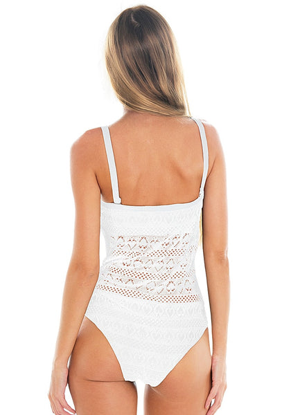 Back view of model in white lace sweetheart-neck swimsuit