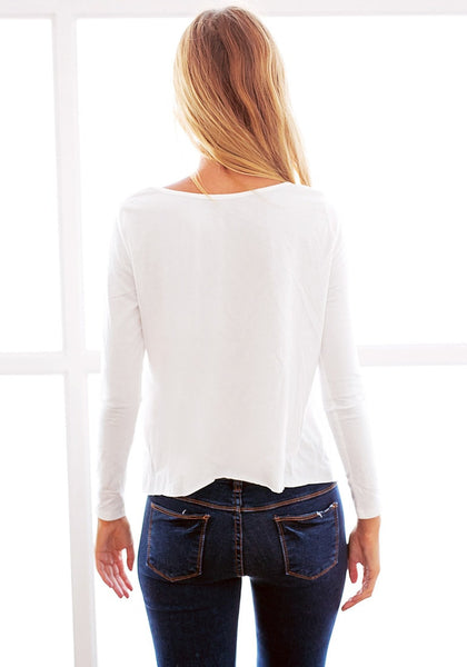 Back view of model in white loose high-low tee