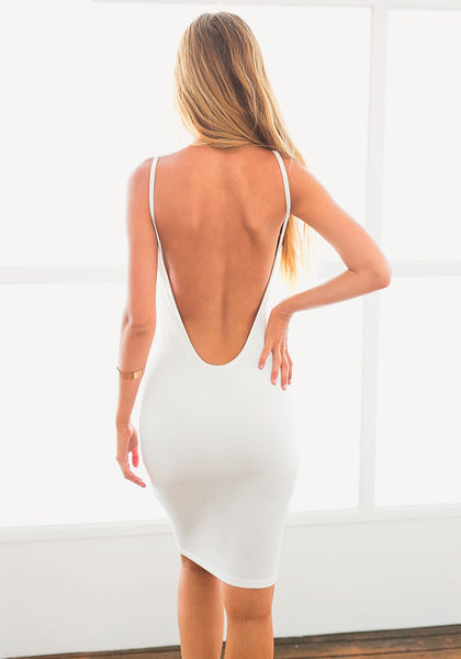 Back view of model in white ribbed cami bodycon dress