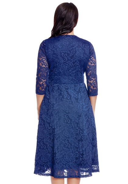 Back view of model plus size royal blue lace surplice midi dress