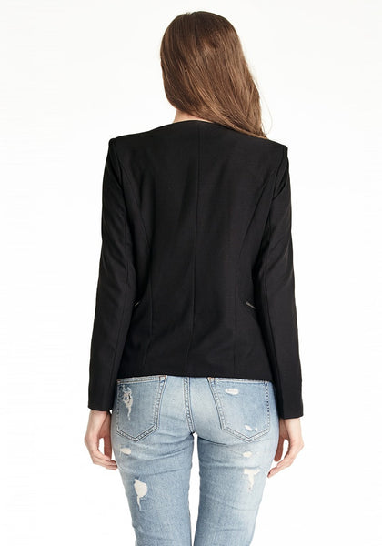 Back view of model wearing a black draped blazer