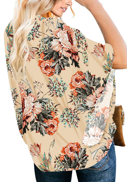 Back view of model wearing apricot V-neck button-up loose kaftan floral top