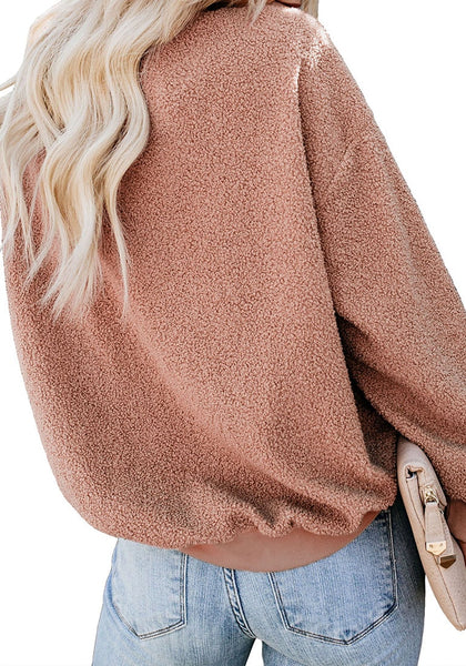 Back view of model wearing apricot crewneck terry cashmere pullover sweatshirt