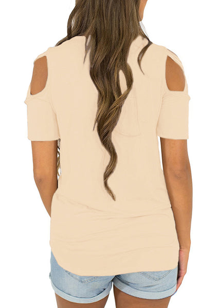Back view of model wearing apricot crisscross cutout shoulder blouse