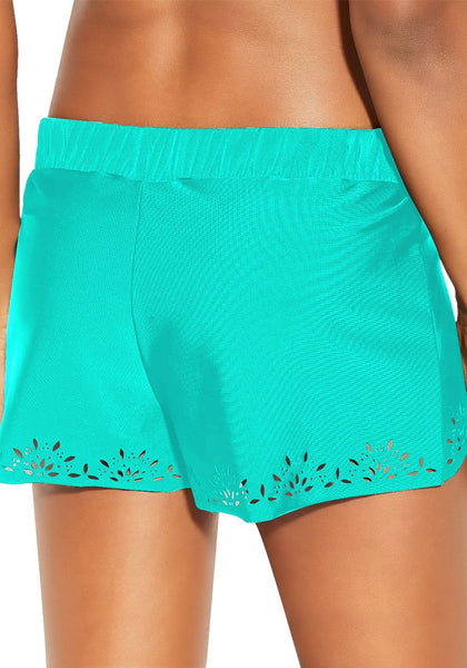 Back view of model wearing aqua blue crochet cutout overlay swim shorts