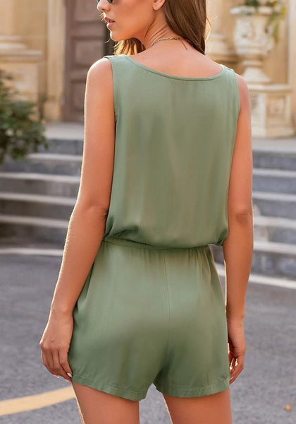 Back view of model wearing army green button-up drawstring-waist sleeveless romper