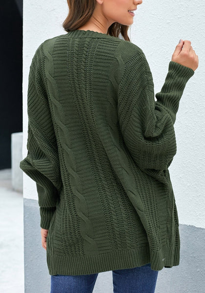 Back view of model wearing army green open-front oversized cable knit cardigan