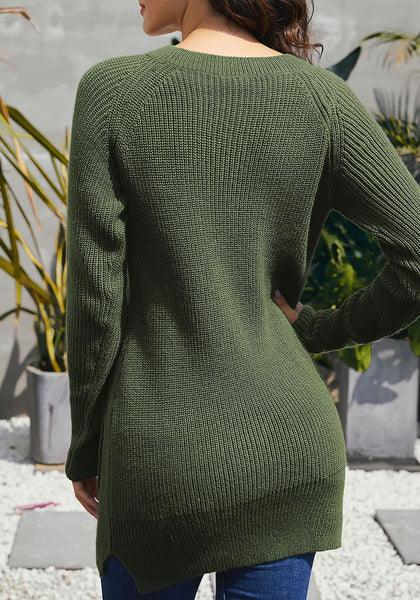 Back view of model wearing army green pockets textured ribbed knit tunic sweater
