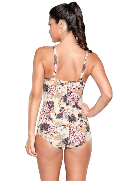 Back view of model wearing beige floral-print ruched swimsuit
