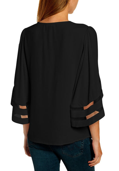 Back view of model wearing black 3/4 bell mesh panel sleeves V-neckline loose top