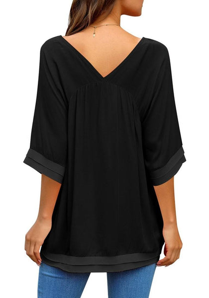 Back view of model wearing black V-neck bell sleeves layered loose tunic top