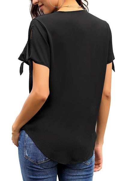 Back view of model wearing black V-neck split tie sleeves loose surplice top