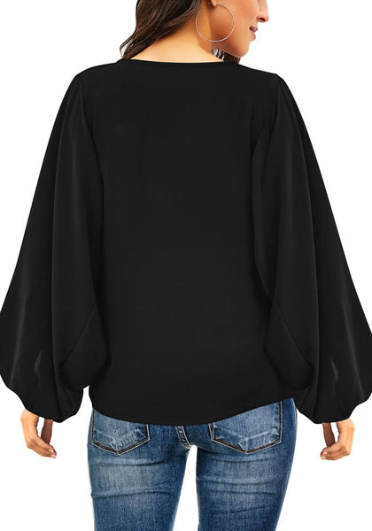 Back view of model wearing black V-neckline balloon sleeve plain blouse
