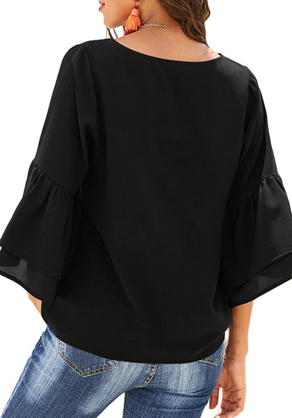 Back view of model wearing black V-neckline layered flared sleeves button-up top