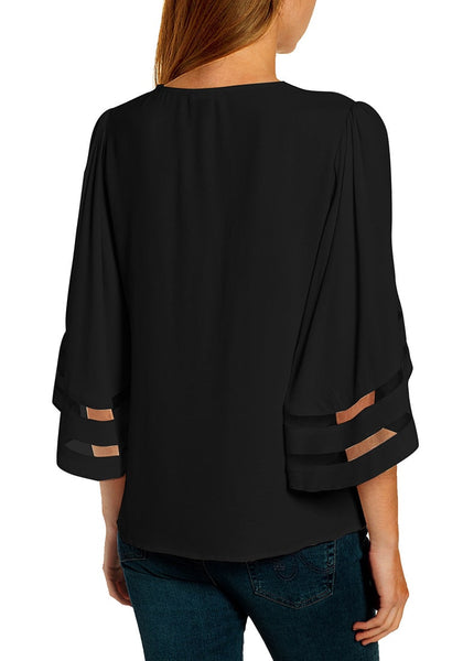 Back view of model wearing black V-neckline mesh bell sleeves loose wrap blouse